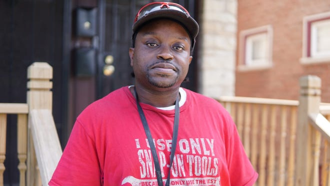 Michael Williams landed a job at Snap-on Inc. after his release from prison. He trained on CNC machines while still incarcerated. He's pictured in front of a duplex that he owns on the near west side of Milwaukee.