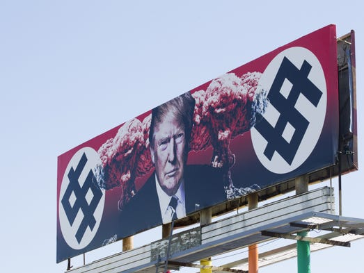 A billboard depicting President Donald Trump flanked