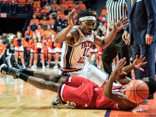 Illinois guard Tracy Abrams (13) and North Carolina State guard Markell Johnson (11) vie for the ball during the first half of an NCAA college basketball game in Champaign, Ill., on Tuesday, Nov. 29, 2016. (AP Photo/Heather Coit)