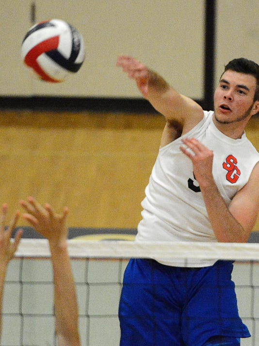 Dalton Forbes of Spring Grove spikes the ball past a Mechanicsburg defender on Monday.