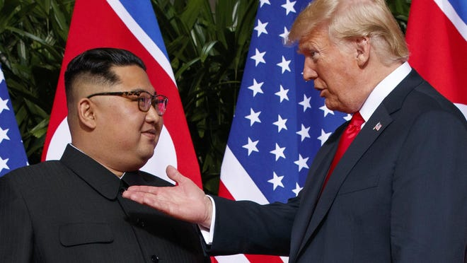 In this June 12, 2018, file photo, President Donald Trump meets with North Korean leader Kim Jong Un on Sentosa Island in Singapore.