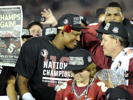 Head coach Jimbo Fisher (right) celebrates with quarterback Jameis Winston (left) after the BCS National Championship game in 2013.