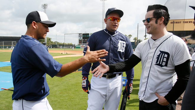 Detroit Tigers Jose Iglesias, left, shakes hands with musician and Detroit native Jack White after Iglesias was introduced by Miguel Cabrera, center, before their game today in Lakeland, Fla.