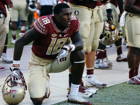 Auden Tate (18) watches UNC celebrate their win at Doak Campbell Stadium on Saturday, October 1, 2016. The Seminoles fell to the Tar Heels 37-35.