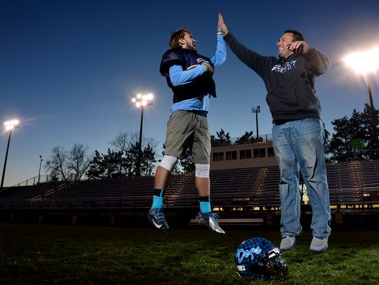Andrew Stanger, left, and his father, Corey, photographed