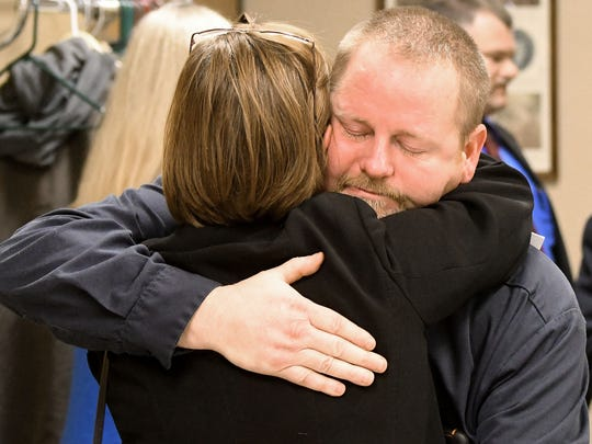 Lonnie Clevenger, son of Patsy Hudson, shares a hug with Assistant Prosecutor Deborah Woodward after Linda Buckner was found guilty on all counts.
