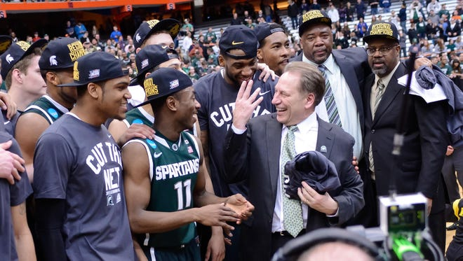 Alvin Ellis, front left, and Tum Tum Nairn (11) were part of Tom Izzo's Michigan State team that went to the Final Four in 2015 by knocking off three higher-seeded teams as the No. 5 seed.