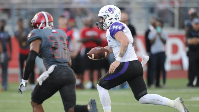 ACU quarterback Dallas Sealey, right, runs for a 13-yard TD for the Wildcats' third score on the night The Wildcats beat Incarnate Word 45-20 in the Southland Conference game Saturday, Sept. 30. 2017 in San Antonio.