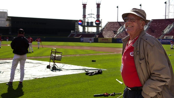 Cincinnati Reds' former radio announcer Joe Nuxhall wears a big smile as he enjoys his final opening day game during the opening day festivities April 5, 2004. Nuxhall retired at the end of the season.