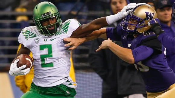 Oct 17, 2015; Seattle, WA, USA; Oregon Ducks kick returner Bralon Addison (2) stiff arms away from a tackle by Washington Huskies kicker Tristan Vizcaino (43) during the third quarter at Husky Stadium. Mandatory Credit: Jennifer Buchanan-USA TODAY Sports