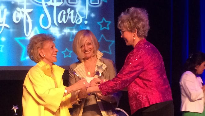 Rancho Mirage Mayor Iris Smotrich honors philanthropists Annette Bloch, left, and Helene Galen during Thursday's State of the City speech at the Omni Rancho Las Palmas.