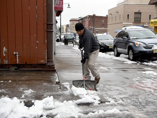 A man shovels on Main Street in Paterson on April 2,