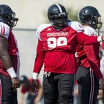 UL defensive lineman Remaine Douglas (99) participates in a play Tuesday at practice in Lafayette.