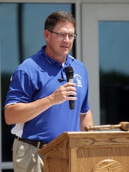 Clear Creek Amana superintendent Tim Kuehl speaks to guests during a cornerstone ceremony at Tiffin Elementary in 2014. A new school, to supplement this school, which would open in 2015 and quickly near capacity, is being planned.