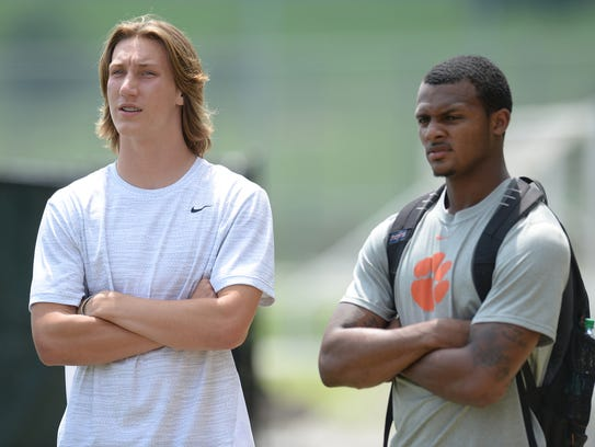 Clemson quarterback Deshaun Watson, right, talks with