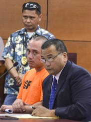 Defense attorney Jay Arriola, right, addresses the