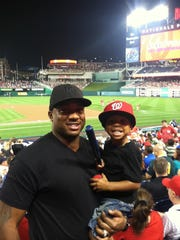 Cato June with son Cato Jr. at a Washington Nationals game.