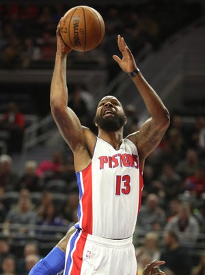 Pistons forward Marcus Morris scores against 76ers forward Robert Covington during the first period Monday at the Palace.