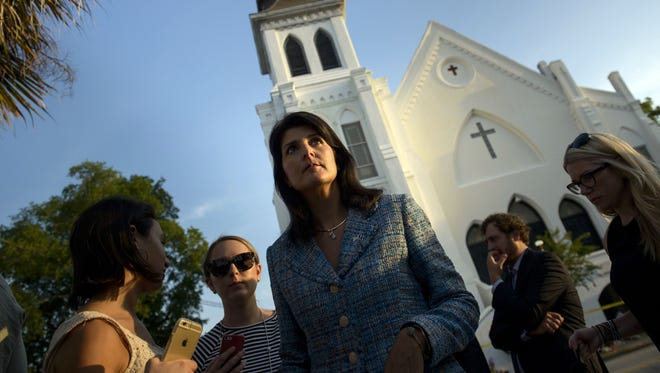South Carolina Governor Nikki Haley waits to speak to press outside the Emanuel AME Church June 19, 2015 in Charleston, South Carolina.