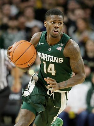 Michigan State Eron Harris dribbles during the second half of an NCAA college basketball game against Oakland, Tuesday, Dec. 22, 2015, in Auburn Hills, Mich.