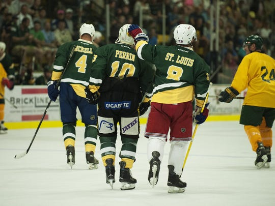 Martin St. Louis and Eric Perrin celebrate a goal during the Greatest Pickup hockey game ever featuring UVM 1996 men's hockey team and alumni at Gutterson Fieldhouse on Saturday morning in Burlington.