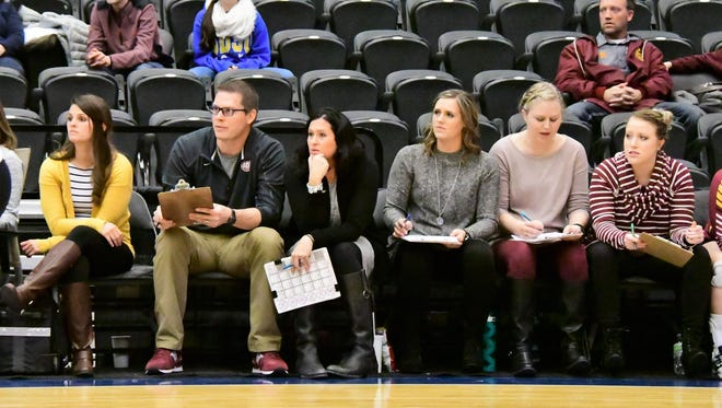 Kevin Vanderwal (second from left) served as an assistant coach under Holly Lynch at Roosevelt since 2008.