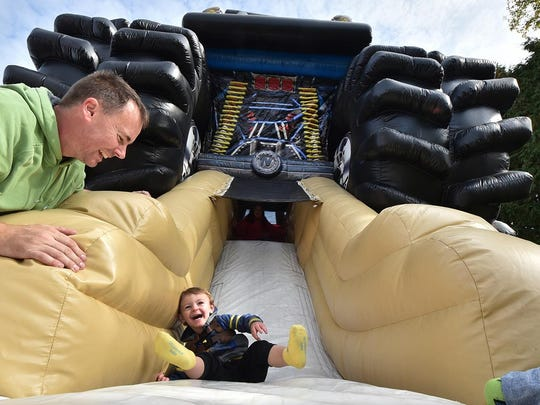 Dan Martin of Sussex watches his son Cash ride the giant inflatable slide at last year's Pumpkin Patch in Egg Harbor.