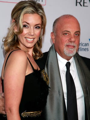 """Alexis Roderick, left, and Billy Joel arrive at the Elton John AIDS Foundation's 12th Annual """"An Enduring Vision"""" benefit gala in New York. Joel married Roderick in a surprise ceremony at the couple's annual July 4 party. The singer's spokeswoman Claire Mercuri says New York Gov. Andrew Cuomo presided over Saturday's nuptials at Joel's Long Island estate."""