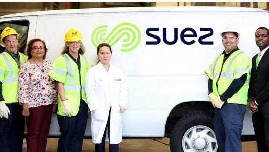 United Water's uniforms and decals reflect the company's new name, Suez.