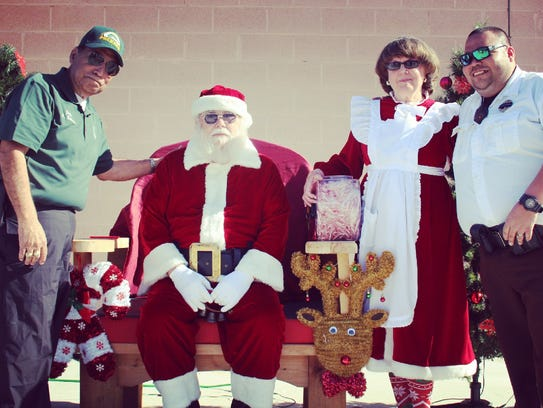 Judge Bobby Balderas, son Randy Balderas and Santa