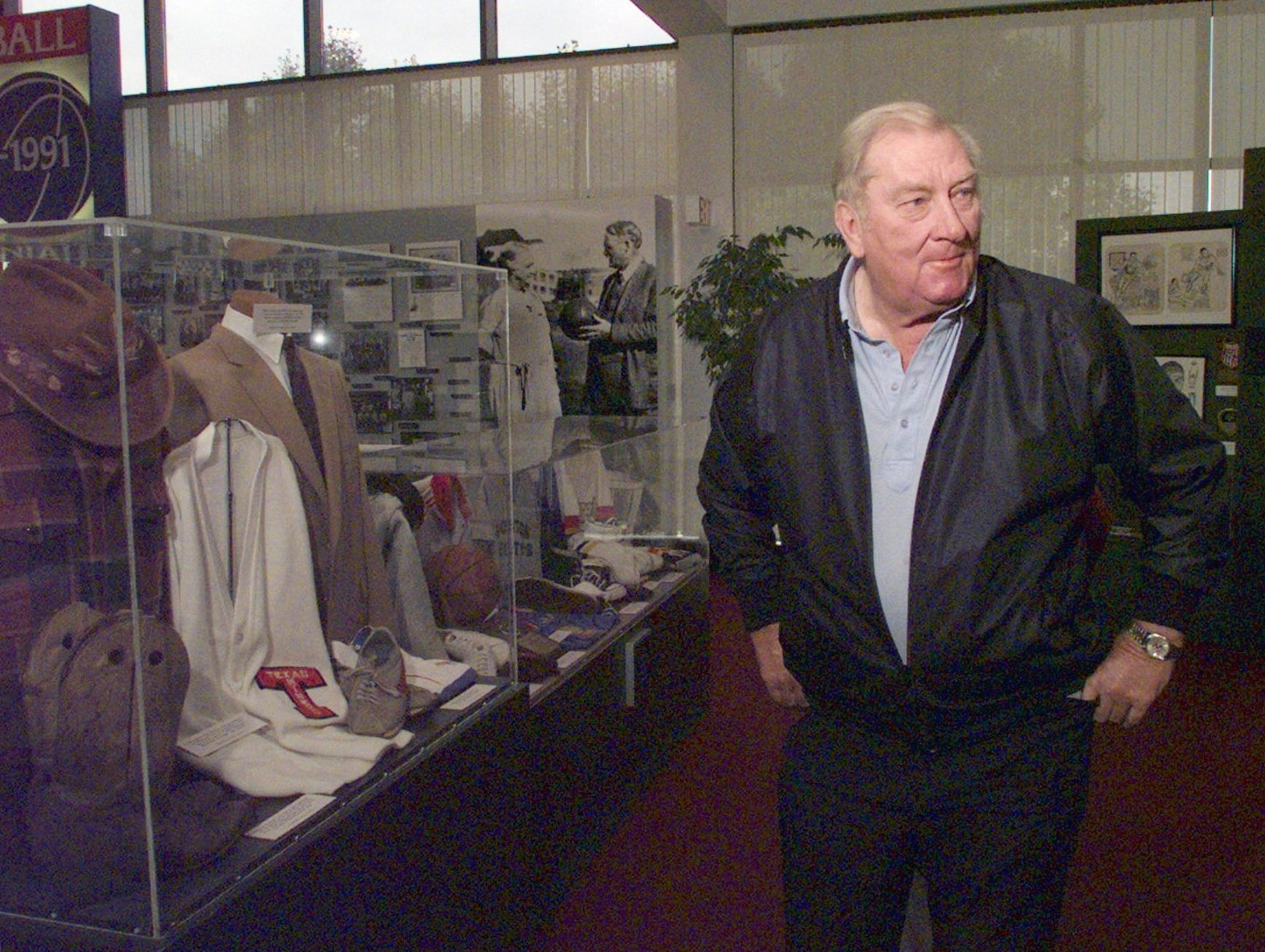 Don Haskins smiles as he inspects his display at the