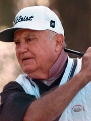 FILE - In this April 10, 1997, file photo, Doug Ford watches his shot during his opening round if the Masters Tournament at the Augusta National Golf Club in Augusta, Ga. Ford, the oldest surviving Masters champion and a Hall of Famer, died Monday, May 14, 2018. He was 95. (AP Photo/Curtis Compton, File)