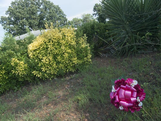 Flowers dropped off at the old residence of John Russell Houser by Sharon Fowler, an old high school friend on Friday.