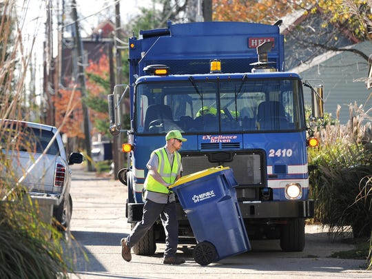 Jason Turner with Republic Services empties recycling cans in an alley at 13th and Ogden streets in Indianapolis on Friday, Nov. 2, 2012.