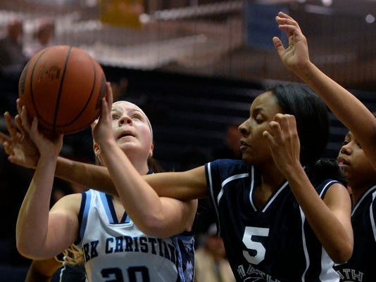 Christian School of York's Bailey Stauffer drives against MCS's Alicia Rippy in the first half of a first-round PIAA basketball game on Saturday, March 7, 2015, at Dallastown. Christian School of York defeated Mathematics, Civics and Sciences Charter School 44-41 to advance in the tournament. Chris Dunn Ñ Daily Record/Sunday News