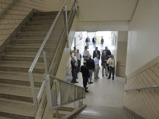 A group of community members and experts including architects, builders, and school officials tour a section of Technical High School Thursday, April 21, near the school's cafeteria. The tour was designed to show the problem areas the school has, renovations needed, and to assess the costs that would be associated with the work if the school was modernized.