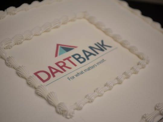 This cake at the Mason office shows Dart Bank's new logo.