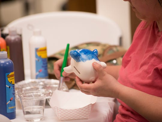 Activities at Dart Bank's Mason office included piggy bank painting for children.