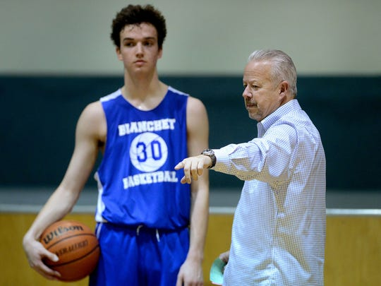 Scott Cantonwine, head coach for the Blanchet Catholic boy's basketball team, leads a practice on Thursday, Dec. 11, 2014.
