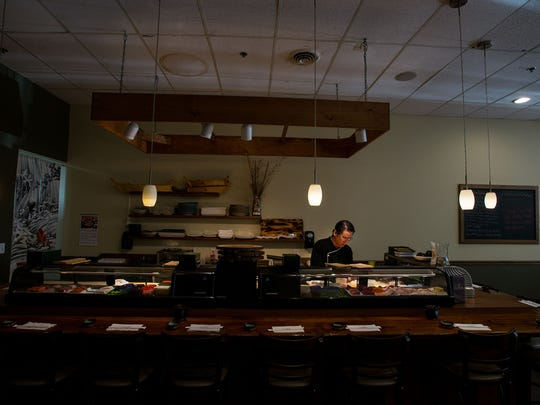 Katsumi Yamauchi, sushi chef at Sushi De Kanpai in downtown Salisbury, prepares fresh sushi.