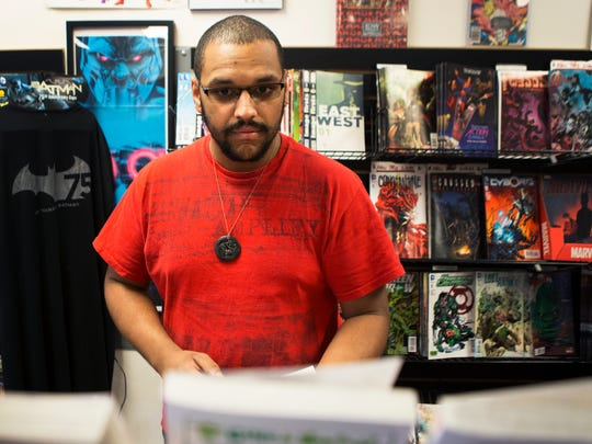 Camden Thornton of Macedon shops at Two Kings comic shop in Victor on Oct. 16, 2015.