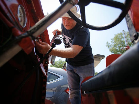 MSU Residential College in the Arts and Humanities academic specialist Steve Baibak works on the 1937 Ford fire engine he and some of his students have been refurbishing Wednesday in Haslett.  The old fire truck will become a mobile community art center, featuring a stage, microphones, bins for art supplies, and a large chalk board.