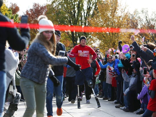 Veteran Rob Jones nears the finish line Nov. 11 in Washington after running his 31st marathon in 31 days to raise money for veterans' charities.