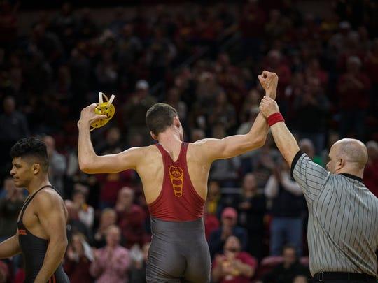 Iowa State's Jarrett Degen celebrates after wrestling