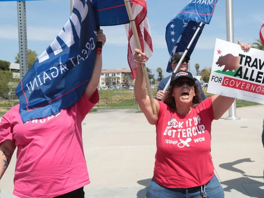 Counter-protesters gather outside of the Unite Inland Empire Conservative Conference in Riverside, Calif., Sunday, April 8, 2018.