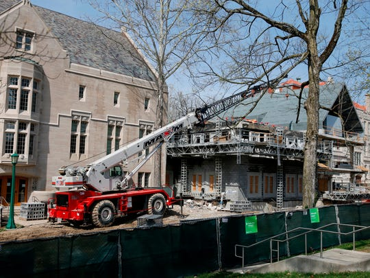 Authorities say a construction worker died when a large chunk of limestone fell onto his head and chest while working at Indiana University's Bloomington campus on Wednesday, April 25, 2018. Pictured is Swain Hall West.