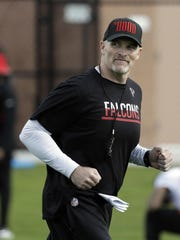 Atlanta Falcons head coach Dan Quinn watches practice