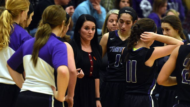 Portland head coach Miranda Cravens talks to her team during a timeout in Tuesday's game at Beech.