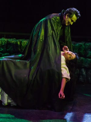 """Randolph Curtis Rand and Ann Sonneville in Actors Theatre of Louisville's 2014 production of """"Dracula."""""""