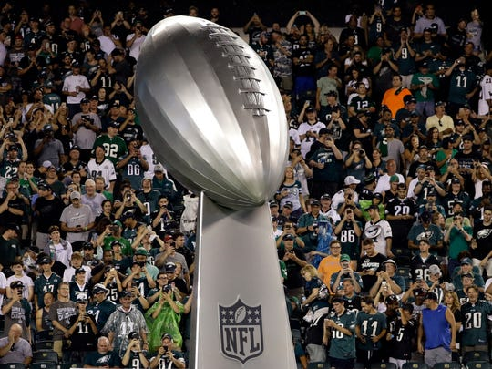A giant replica of the Vince Lombardi Trophy is wheeled onto the field before an NFL football game between the Philadelphia Eagles and the Atlanta Falcons, Thursday, Sept. 6, 2018, in Philadelphia. (AP Photo/Michael Perez)